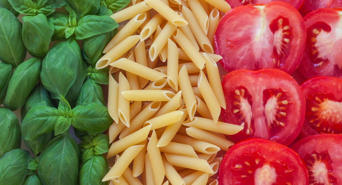 italian food with background - pasta, tomato, basil