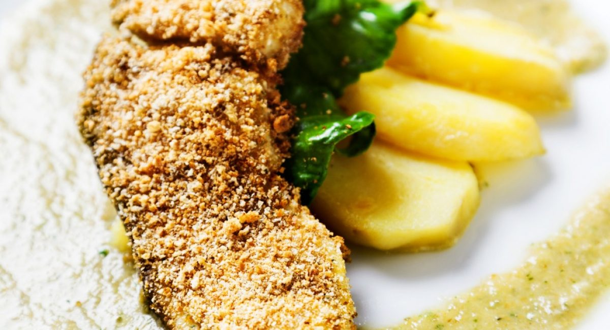 swordfish-breaded-with-potatoes-and-green-sauce-picture-id496632820